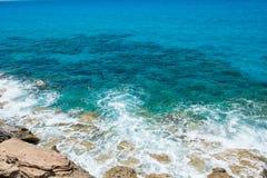 Waves crushing rocky coastline Stock Photography