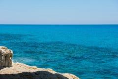 Waves crushing rocky coastline Stock Images