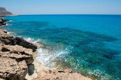 Waves crushing rocky coastline Royalty Free Stock Image