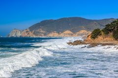 Rugged Northern Californa beach in Montara near San Francisco on. Waves crushing on a rugged Northern Californa beach in Montara near San Francisco on a sunny stock photography