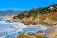 Rugged Northern Californa beach in Montara near San Francisco on. Waves crushing on a rugged Northern Californa beach in Montara near San Francisco on a sunny stock images