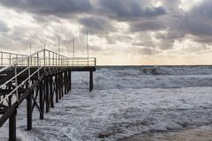 Pier in the storming sea Stock Photos