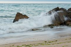 Surf and rocks. Waves crushing on the stones on the sea-coast Stock Images