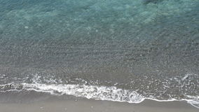 Waves of crystal clear water coming to a tropical beach. From above stock footage