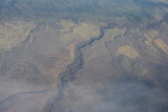 The Waves of Earth. I really love taking pictures from planes and I got lucky with a mostly clear window that allowed me to have a good shot of the ground below Royalty Free Stock Image