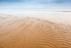 Waves on empty sandy coast Royalty Free Stock Image