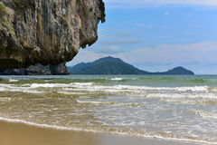 Waves eroding a cliff on a tropical island in Krabi Stock Photos
