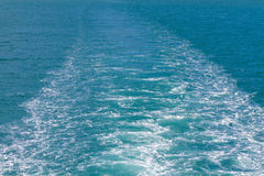 Waves of a ferry crossing the ocean Royalty Free Stock Images