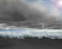 Waves flooded with dramatic weather, lightning, sky and sun ligh Stock Images
