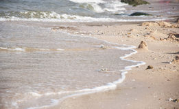 Waves that are flowing into the shore. Stock Image