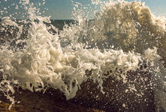 Waves with foam on the background. Summer Stock Images