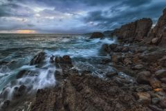 Waves and foam in the Cantabrico sea, in Bermeo royalty free stock photos