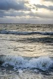 Waves of foam spray. In the ocean Stock Images