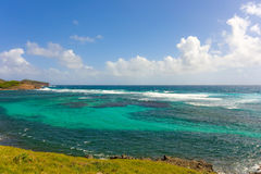 Waves foaming over reefs in the windward islands Royalty Free Stock Photo
