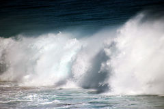 Waves Foaming on the Rocks Royalty Free Stock Images