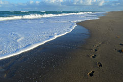 Waves and footprints Stock Image