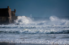 Fort. Some waves breaking on a fort in Carcavelos beach - Portugal Royalty Free Stock Image