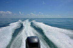 Waves From Motor On Water Stock Photo