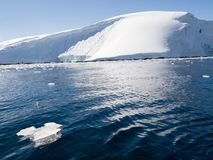 Waves in front of glacier stock photography