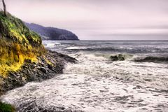 Stormy seas on the Oregon coast. Waves and frothy water along the Oregon coastline royalty free stock image