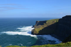 Waves from Galway Bay Crashing Against the Cliff`s of Moher Stock Photography