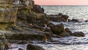 Waves Gently Splashing Against Rocks stock video