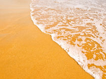Waves on the gilded sand Royalty Free Stock Images