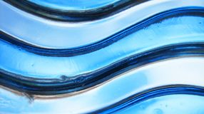 Waves of glass. Glass structure in wave form Royalty Free Stock Photos