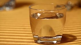 Waves in a glass of water stock footage