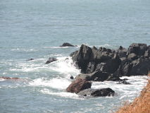 Waves in Goa. Sea waves hitting the rock Stock Photos