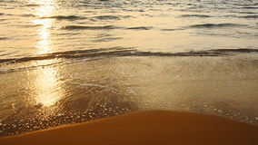 Waves and golden sand beach stock video footage