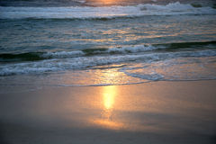 Waves and golden sandy beach Royalty Free Stock Image