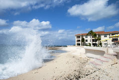 Waves in Grand Cayman. The wave hitting Seven Mile Beach on Grand Cayman island (Cayman Islands royalty free stock image