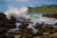 Waves hard crashing coral Stock Photo
