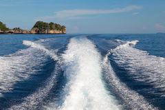 The waves from a high-speed boat and island background,selective focus Stock Image