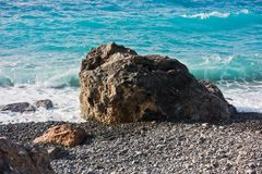 Waves hit huge rock on a beach at E4 trail near Paleochora, south west part of Crete island stock images