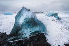 Icy Wave. Waves hit the ice at Jokulsarlon beach Royalty Free Stock Photo