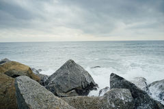 Waves hit the rock at Venice Beach, California. In Spring Stock Photography