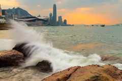 Waves hit rock in Victoria Harbour of Hong Kong Royalty Free Stock Image