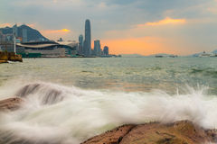 Waves hit rock in Victoria Harbour of Hong Kong Royalty Free Stock Photos