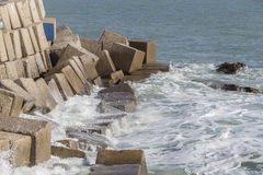 Waves hit the rocks on the promenade of the La Caleta beach in C Stock Image