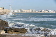 Waves hit the rocks on the promenade of the La Caleta beach in C Stock Photo