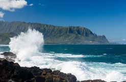 Waves hit rocks at Queens Bath Kauai Royalty Free Stock Images