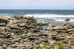 Waves hit the rocks. On a beach in Itanhaem stock image