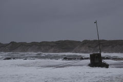 Waves hitting against the beach during storm in Nr. Vorupoer on the North Sea coast in Denmark Stock Photos