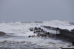 waves hitting against the pier during the storm in Nr. Vorupoer on the North Sea coast Royalty Free Stock Images