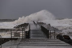 Waves hitting against the pier during the storm in Nr. Vorupoer on the North Sea coast. In Denmark stock images