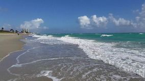 Wild tropical sandy beach with waves stock video footage