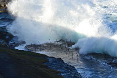 Waves hitting the bogey hole. Also known as the commandants baths Royalty Free Stock Photo