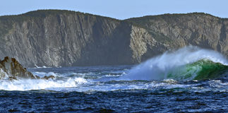 Waves hitting cliff walls in Middle Cove in Newfoundland Stock Photo